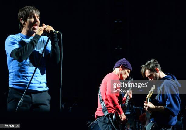 Musicians Anthony Kiedis Flea and Josh Klinghoffer of Red Hot Chili Peppers perform at the Lands End Stage during day 3 of the 2013 Outside Lands...