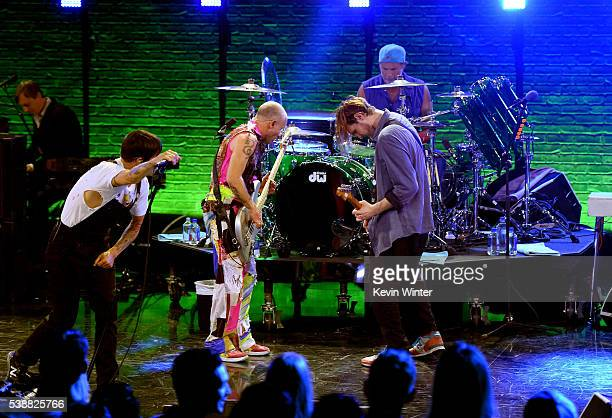 Musicians Anthony Kiedis Flea Josh Klinghoffer and Chad Smith of Red Hot Chili Peppers perform onstage during their album release party on ATT LIVE...