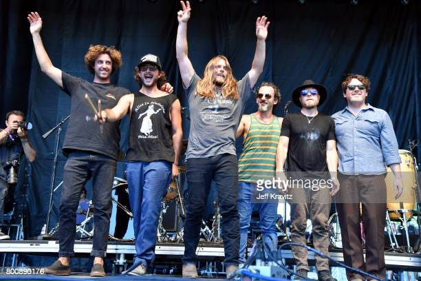 Musicians Anthony LoGerfo Lukas Nelson Tato Melgar and Corey McCormick of musical group Lukas Nelson Promise of the Real performs on the Sycamore...