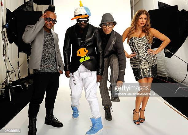 Musicians apldeap william Taboo and Fergie of Black Eyed Peas pose for a portrait during the 2010 American Music Awards held at Nokia Theatre LA Live...