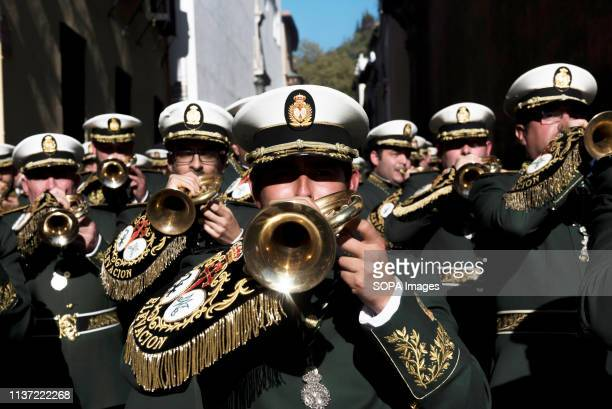 Musicians are seen playing bugles during the Palm Sunday procession in Granada Every year thousands of Christian believers celebrate the Holy Week of...