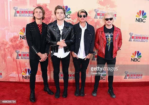 Musicians Ashton Irwin, Calum Hood, Luke Hemmings and Michael Clifford of 5 Seconds of Summer attend the 2015 iHeartRadio Music Awards which...