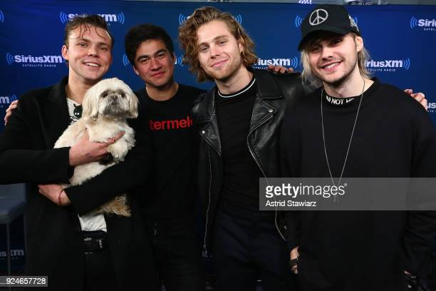 Musicians Ashton Irwin Calum Hood Luke Hemmings and Michael Clifford of 5 Seconds of Summer pose for photos during a town hall at the SiriusXM...