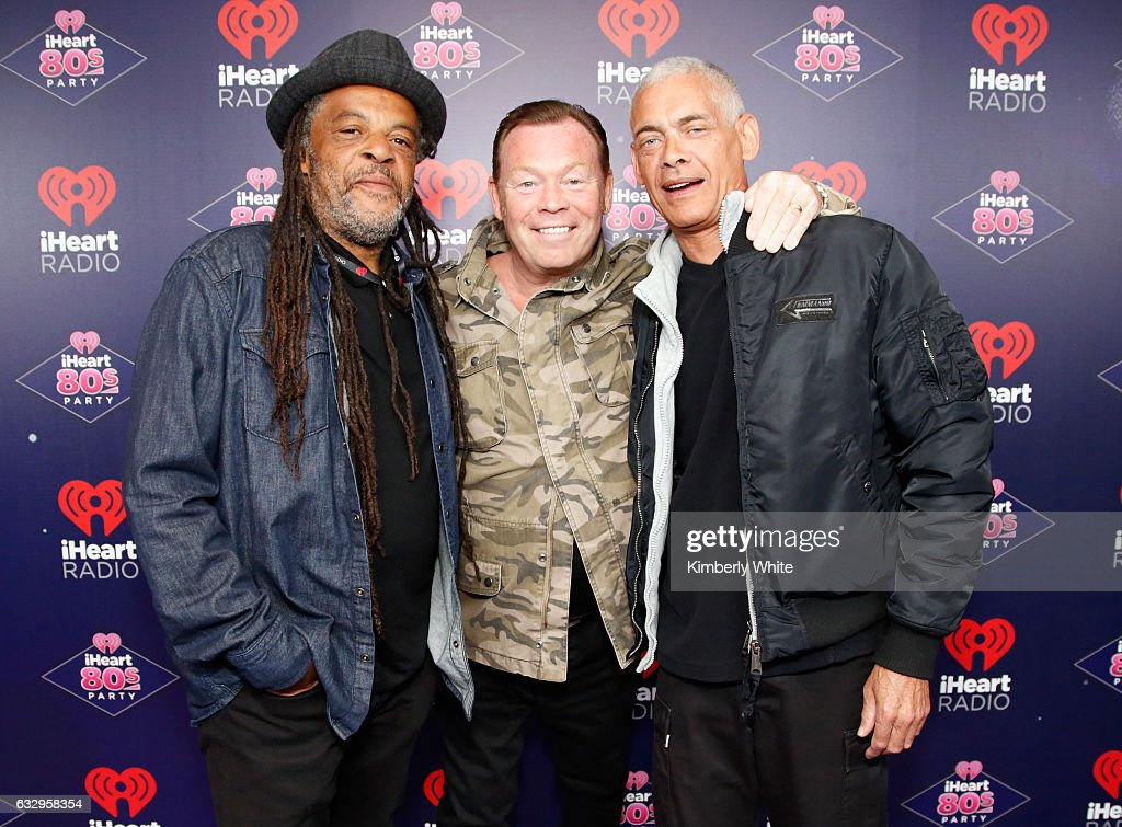 Musicians Astro, Ali Campbell and Michael Virtue of UB40 arrive at the iHeart80s Party 2017 at SAP Center on January 28, 2017 in San Jose, California.