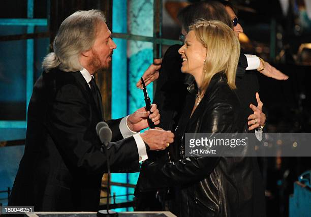 Musicians Barry Gibb of the Bee Gees and inductee AnniFrid Prinsessan Reuss of ABBA speak onstage at the 25th Annual Rock and Roll Hall of Fame...