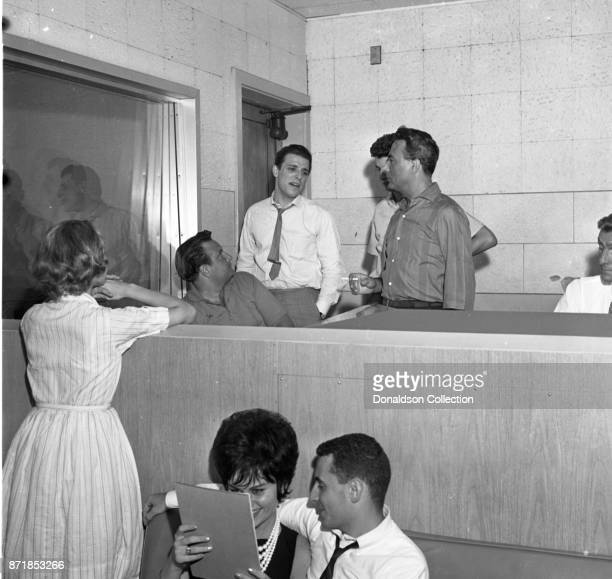 Musicians Barry Mann records for JDS Records with Carole King Don Kirshner Gerry Goffin and Al Nevins on July 18 1959 in New York