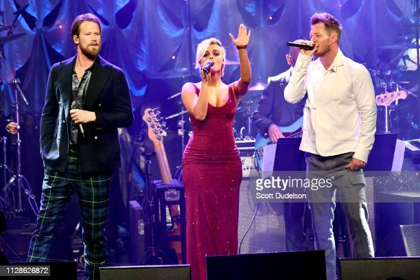 Musicians Bebe Rexha performs as a special guest onstage with Brian Kelley and Tyler Hubbard of Florida Georgia Line during The Recording Academy and...