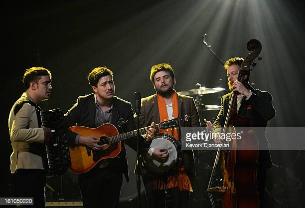 Musicians Ben Lovett Marcus Mumford 'Country' Winston Marshall and Ted Dwane of Mumford Sons perform onstage at The 2013 MusiCares Person Of The Year...