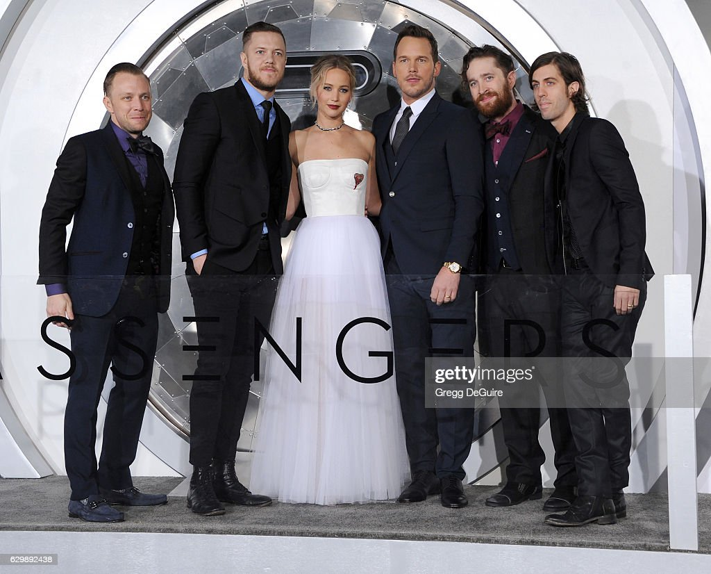 Musicians Ben McKee and Dan Reynolds of Imagine Dragons, actors Jennifer Lawrence and Chris Pratt, and musicians Daniel Platzman and Daniel Wayne Sermon of Imagine Dragons arrive at the premiere of Columbia Pictures' 'Passengers' at Regency Village Theatre on December 14, 2016 in Westwood, California.