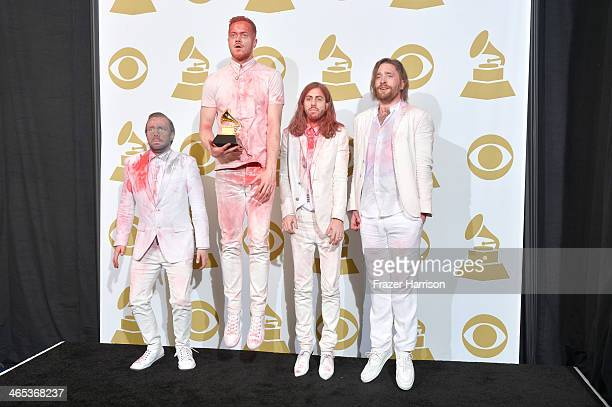 Musicians Ben McKee Dan Reynolds Wayne Sermon and Daniel Platzman of Imagine Dragons winners of the Best Rock Performance Award for 'Radioactive'...