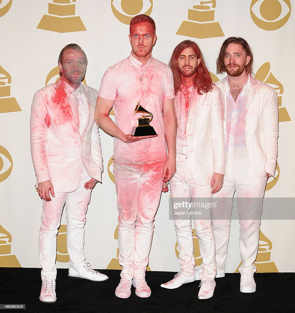 Musicians Ben McKee, Dan Reynolds, Wayne Sermon, and Daniel Platzman of Imagine Dragons, winners of the Best Rock Performance Award for 'Radioactive' pose in the press room at the 56th GRAMMY Awards at Staples Center on January 26, 2014 in Los Angeles, California.