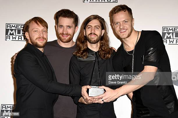 Musicians Ben McKee Daniel Platzman Daniel Wayne Sermon and Dan Reynolds of Imagine Dragons pose in the press room at the 2014 American Music Awards...
