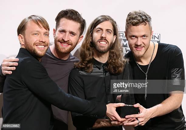 Musicians Ben McKee Daniel Platzman Daniel Wayne Sermon and Dan Reynolds of Imagine Dragons pose in the press room at the 2014 American Music Awards...