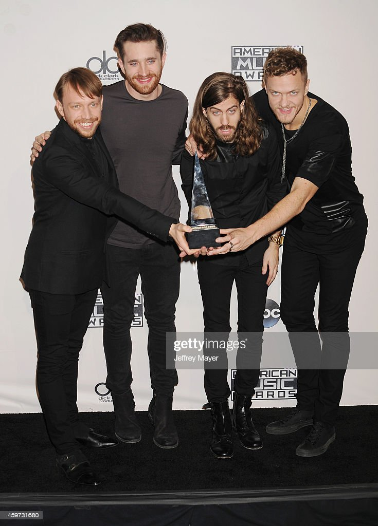 Musicians Ben McKee, Daniel Platzman, Daniel Wayne Sermon and Dan Reynolds of Imagine Dragons pose in the press room at the 2014 American Music Awards at Nokia Theatre L.A. Live on November 23, 2014 in Los Angeles, California.