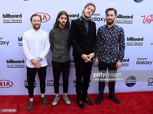 Musicians Ben McKee, Wayne Sermon, Dan Reynolds, and Daniel Platzman of Imagine Dragons attend the 2015 Billboard Music Awards at MGM Grand Garden...