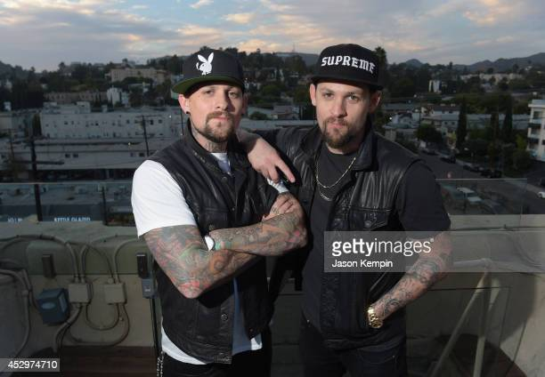 Musicians Benji Madden and Joel Madden attend the 987 FM's Penthouse Party Pad at The Historic Hollywood Tower on July 30 2014 in Hollywood California