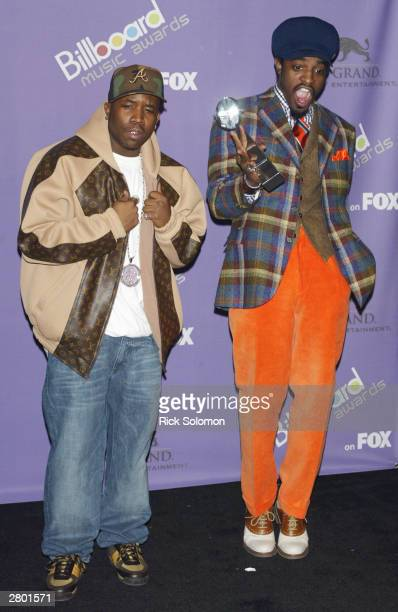 """Musicians Big Boi and Andre 3000 of OutKast pose backstage with their """"Digital Track of the Year"""" award during the 2003 Billboard Music Awards at the..."""