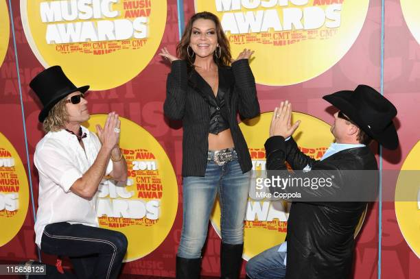 Musicians Big Kenny Gretchen Wilson and John Rich attend the 2011 CMT Music Awards at the Bridgestone Arena on June 8 2011 in Nashville Tennessee