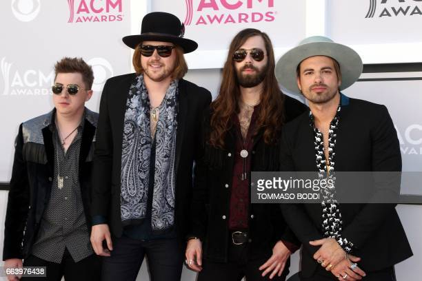 Musicians Bill Satcher Michael Hobby Graham DeLoach and Zach Brown of A Thousand Horses pose as they arrive for the 52nd Academy of Country Music...