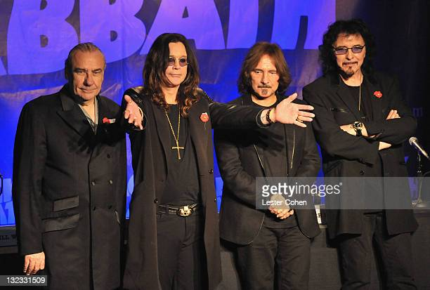 Musicians Bill Ward Ozzy Osbourne Geezer Butler and Tony Iommi pose onstage during Black Sabbath Reunion Press Conference at The Whisky a Go Go on...