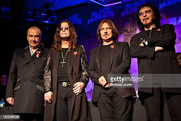 Musicians Bill Ward Ozzy Osbourne Geezer Butler and Tony Iommi pose onstage during Black Sabbath Reunion Press Conference at Whisky a Go Go on...