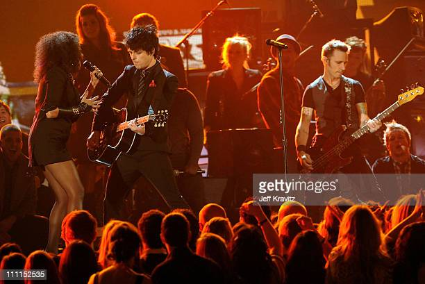 Musicians Billie Joe Armstrong and Mike Dirnt of Green Day perform with cast of 'American Idiot' onstage during the 52nd Annual GRAMMY Awards held at...