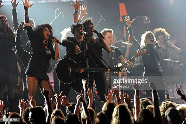 Musicians Billie Joe Armstrong Mike Dirnt and Tre Cool of Green Day perform with cast of 'American Idiot' onstage during the 52nd Annual GRAMMY...