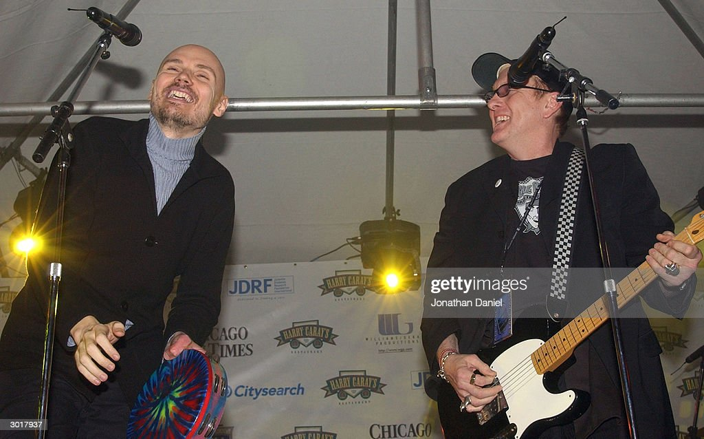Musicians Billy Corgan (l) and Rick Nielson perform before the ceremony to destroy the cursed Chicago Cubs baseball on February 26, 2004 at Harry Caray's Restaurant in Chicago, Illinois. The alleged curse comes from a play during the NLCS where Luis Castillo of the Marlins hit a foul ball that Cubs fan Steve Bartman touched. This prevented Cubs' leftfielder Moises Alou from catching the ball which would have been the 2nd out of the 8th inning, instead the Marlins started a rally and went on to win the game, which forced a game 7 that the Marlins also won, on their way to becoming World Series Champs.
