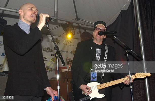 Musicians Billy Corgan and Rick Nielson perform before the ceremony to destroy the cursed Chicago Cubs baseball on February 26 2004 at Harry Caray's...