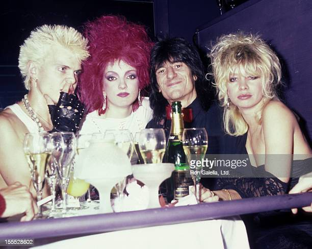 Musicians Billy Idol Perri Lister Ron Wood and wife attend the party for Billy Idol on April 10 1984 at The Cat Club in New York City
