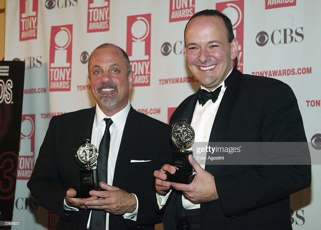 Musicians Billy Joel and Stuart Malina pose backstage after winning win Best Orchestration for 'Movin' Out' at the '57th Annual Tony Awards' at Radio City Music Hall on June 8, 2003 in New York City. The Tony Awards are presented by the League of American Theatres and Producers and the American Theatre Wing.