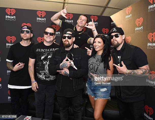 Musicians Billy Martin Paul Thomas Dean Butterworth and Benji Madden of Good Charlotte radio personality Theresa RockFace and Joel Madden of Good...