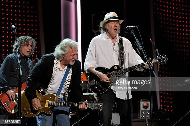 Musicians Billy Talbot Frank Sampedro and Neil Young of the band Crazy Horse perform onstage at the 2012 MusiCares Person of the Year Tribute to Paul...