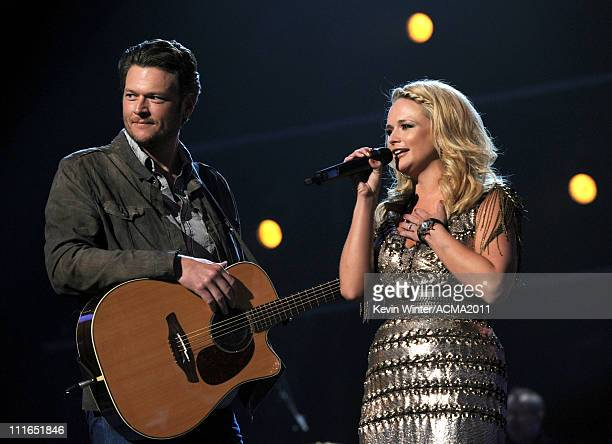 Musicians Blake Shelton and Miranda Lambert speak onstage during ACM Presents Girls' Night Out Superstar Women of Country concert held at the MGM...