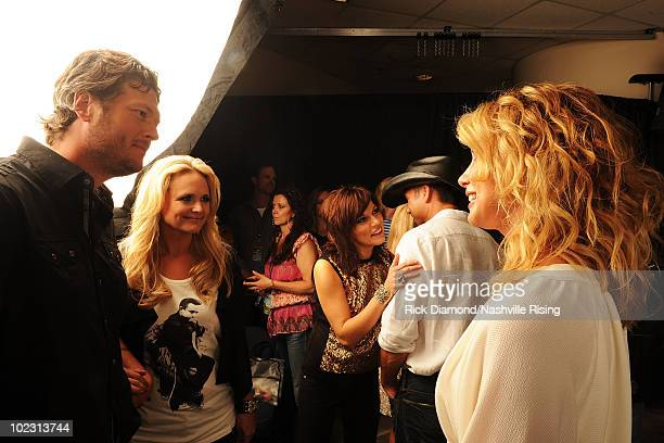 Musicians Blake Shelton Miranda Lambert and Faith Hill attend Nashville Rising a benefit concert for flood relief at Bridgestone Arena on June 22...