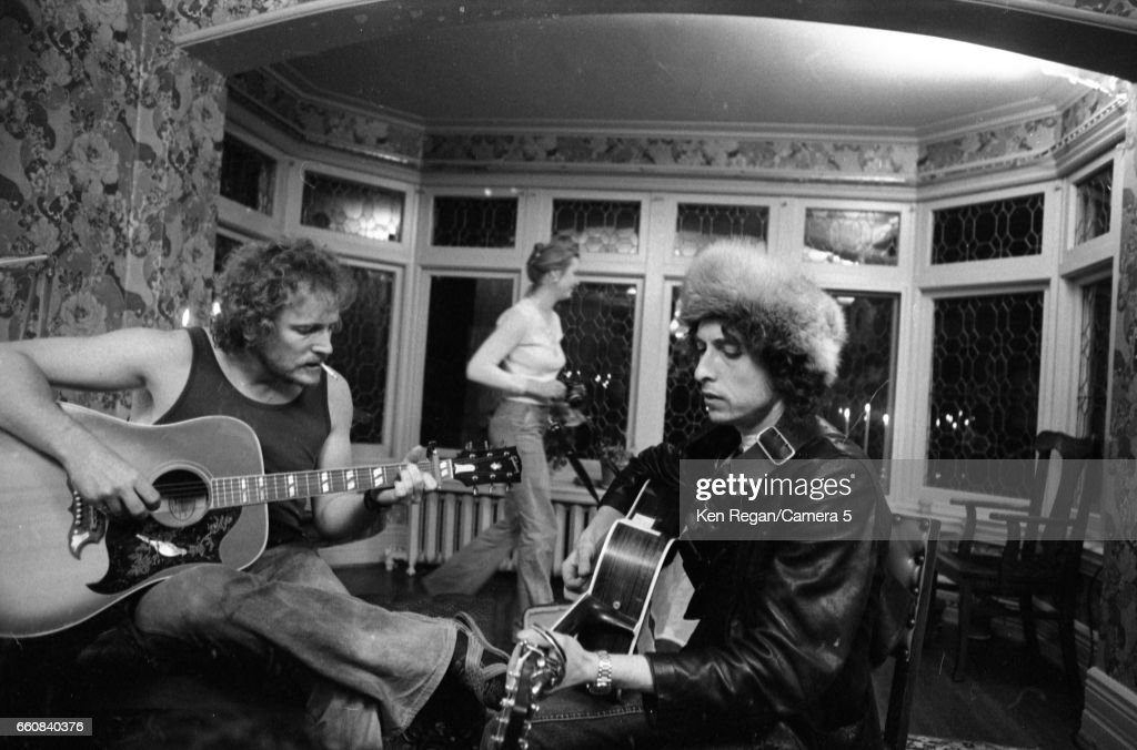 Musicians Bob Dylan and Gordon Lightfoot are photographed at Gordon Lightfoot's house during the Rolling Thunder Revue in December 1975 in Toronto, Ontario.