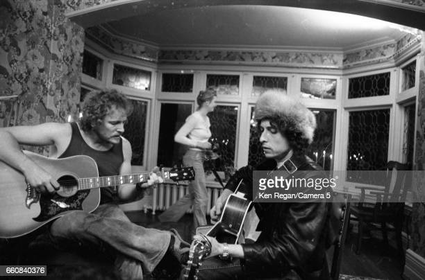 Musicians Bob Dylan and Gordon Lightfoot are photographed at Gordon Lightfoot's house during the Rolling Thunder Revue in December 1975 in Toronto...
