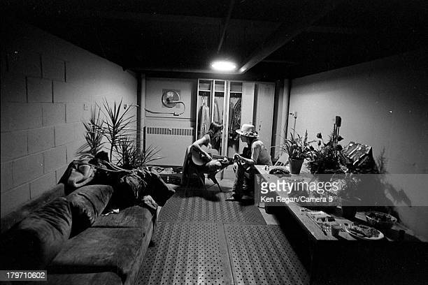 Musicians Bob Dylan and Joan Baez are photographed backstage during the Rolling Thunder Revue in November 1975 CREDIT MUST READ Ken Regan/Camera 5...