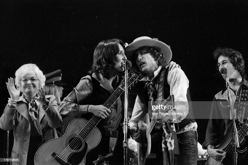 Musicians Bob Dylan and Joan Baez are photographed during the Rolling Thunder Revue in December 1975 in Toronto, Ontario.
