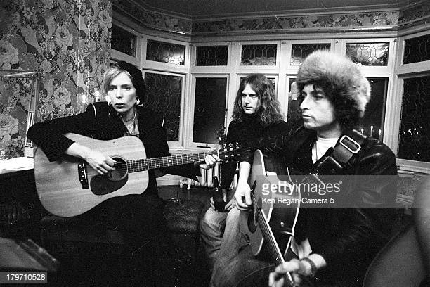 Musicians Bob Dylan and Joni Mitchell are photographed at Gordon Lightfoot's house during the Rolling Thunder Revue in December 1975 in Toronto...