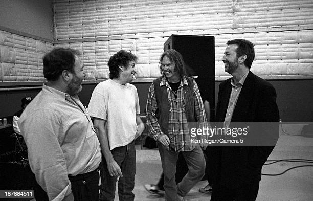 Musicians Bob Dylan Neil Young and Eric Clapton are photographed behind the scenes of Bob Dylan's 30th Anniversay Concert on October 16 1992 in New...