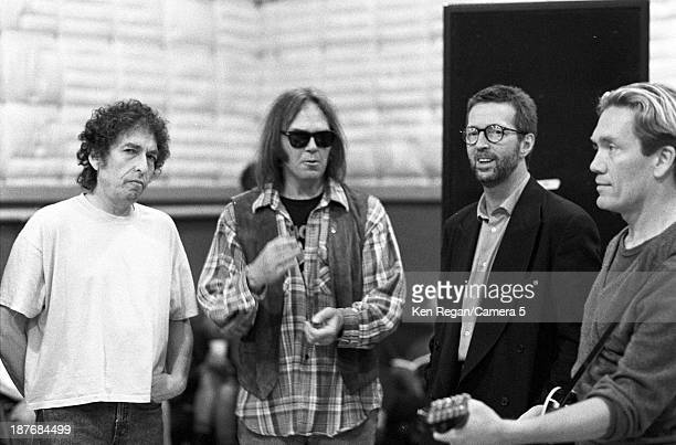 Musicians Bob Dylan Neil Young Eric Clapton and GE Smith are photographed behind the scenes of Bob Dylan's 30th Anniversay Concert on October 16 1992...