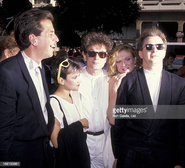 Musicians Bob Mothersbaugh and wife Mark Mothersbaugh and wife and Gerald Casale and wife of Devo attend the premiere of 'Purple Rain' on July 26...
