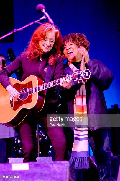 Musicians Bonnie Raitt and Mavis Staples perform together Chicago Illinois May 31 2003