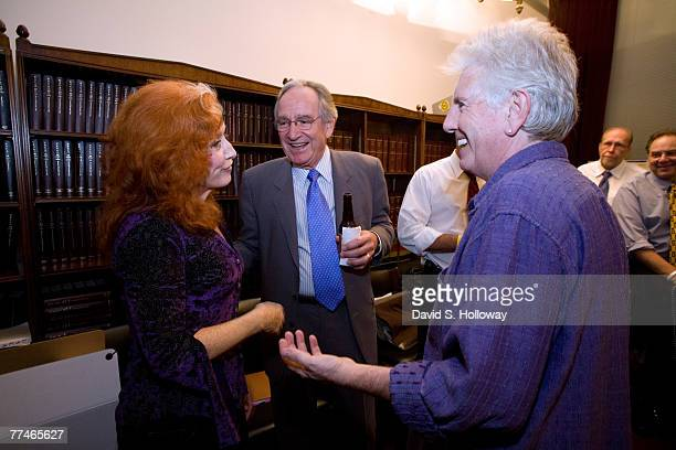 Musicians Bonnie Raitt left and Graham Nash right speak with former Iowa senator Tom Harkin after their performance in the Cannon House Office...