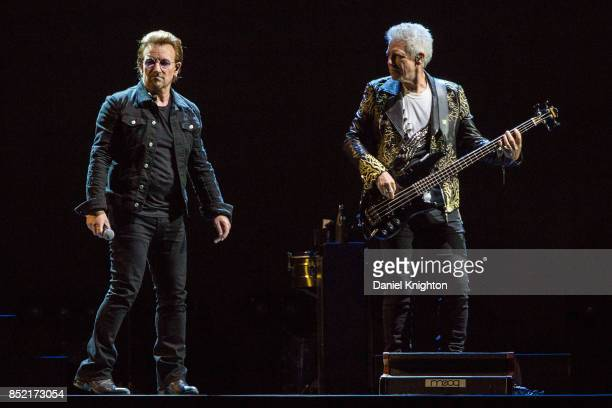 Musicians Bono and Adam Clayton of U2 perform on stage on the final night of U2 The Joshua Tree Tour 2017 at SDCCU Stadium on September 22 2017 in...