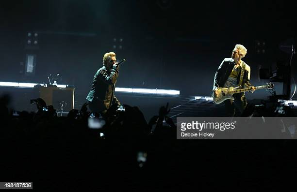 Musicians Bono and Adam Clayton of U2 perform onstage at 3 Arena on November 23 2015 in Dublin Ireland