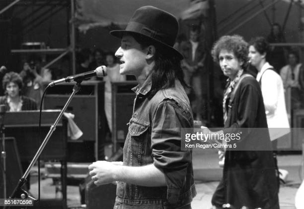 Musicians Bono and Bob Dylan are photographed at Slaine Castle performance in 1984 in Dublin Ireland CREDIT MUST READ Ken Regan/Camera 5 via Contour...