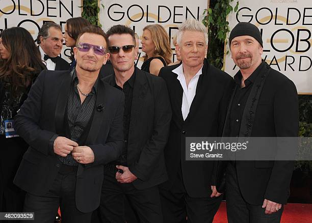 Musicians Bono Larry Mullen Jr Adam Clayton and The Edge of U2 attend the 71st Annual Golden Globe Awards held at The Beverly Hilton Hotel on January...
