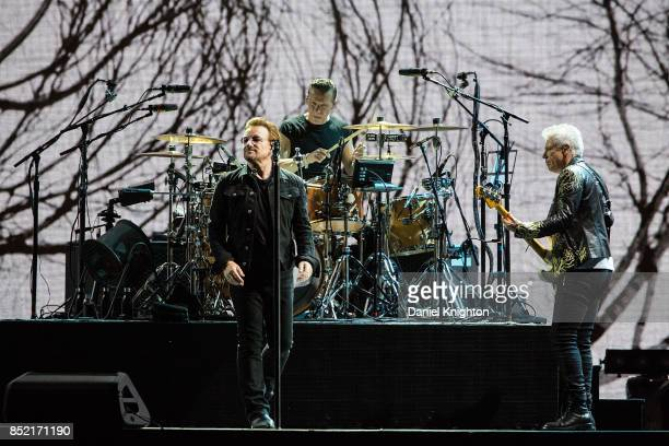 Musicians Bono Larry Mullen Jr and Adam Clayton perform on stage on the final night of U2 The Joshua Tree Tour 2017 at SDCCU Stadium on September 22...
